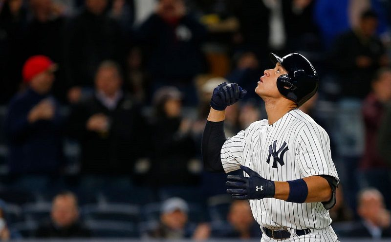 Aaron Judge of the New York Yankees gestures after he hit a home run against the Chicago White Sox at Yankee Stadium on April 19, 2017.