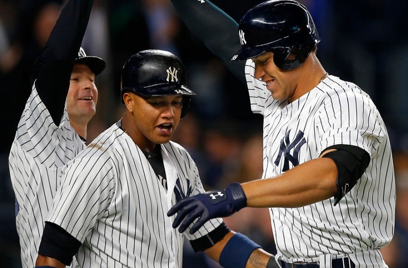 Closeup of Aaron Judge, Chase Headley, and Starlin Castro celebrating after Judge's home run on May 3, 2017