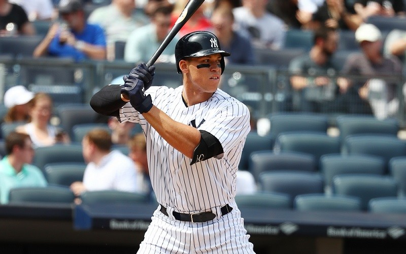 Aaron Judge hits in front of a largely empty section behind the visitor's dugout on April 29, 2017.