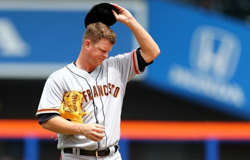 Giants starter Matt Cain looks discouraged as he walks off the field.