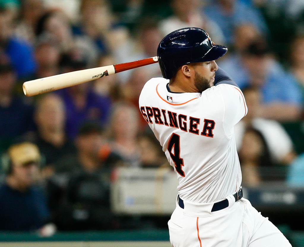 George Springer swings at a pitch