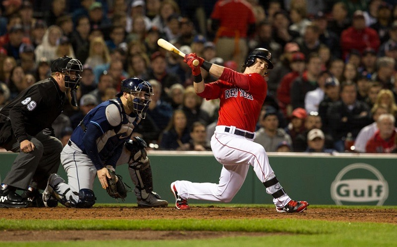 Andrew Benintendi of the Boston Red Sox strikes out against the Tampa Bay Rays.