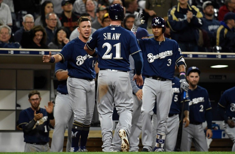 Travis Shaw #21 of the Milwaukee Brewers is congratulated after scoring.