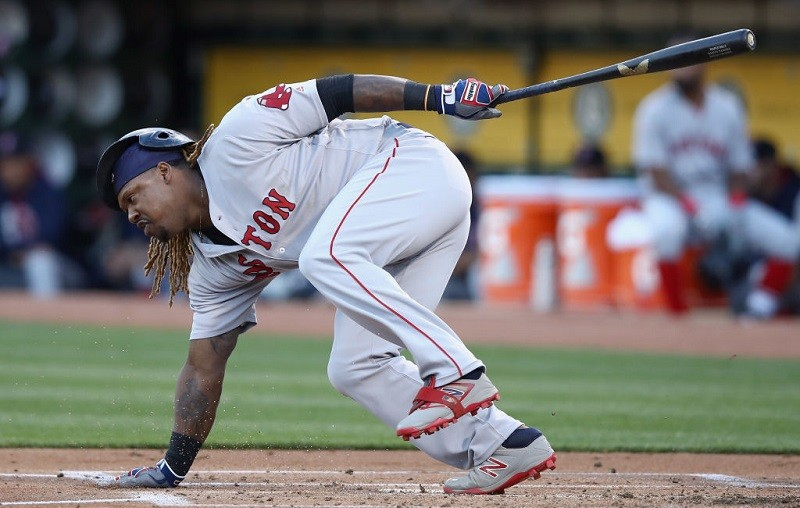 Hanley Ramirez touches the ground as he slips.