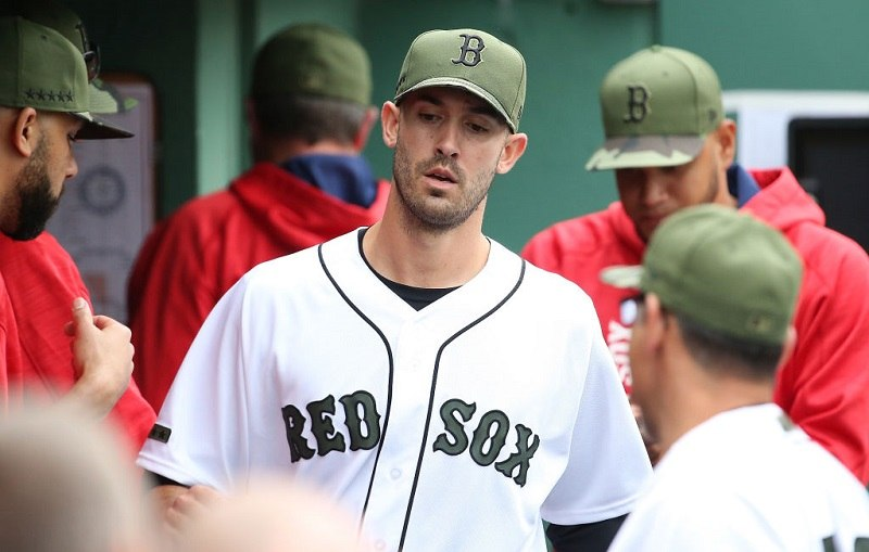 Rick Porcello looks disappointed in the dugout on Memorial Day.