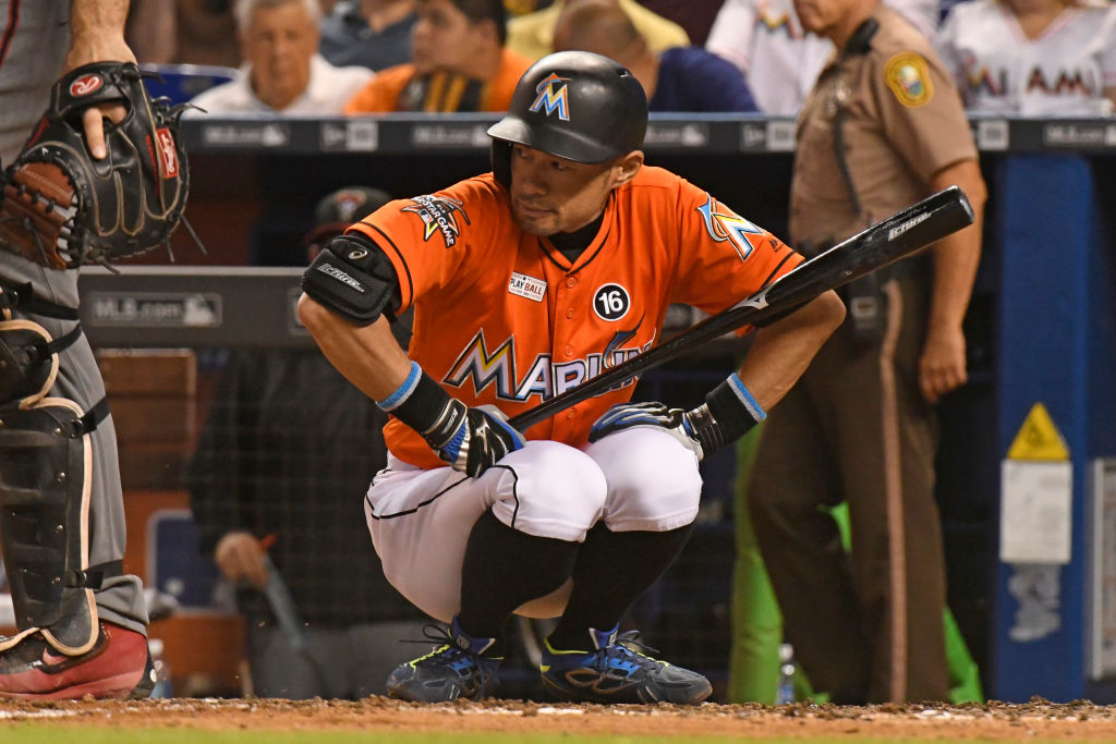 MLB legend Ichiro Suzuki holds his bat before he goes up to the plate.