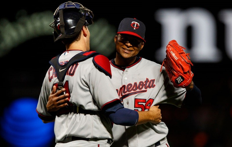 Ervin Santana of the Minnesota Twins celebrates with Jason Castro after a game.
