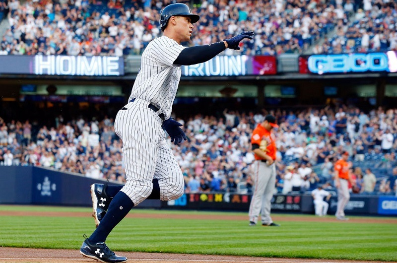 Aaron Judge rounds the bases after hitting a home run off Chris Tillman at Yankee Stadium.