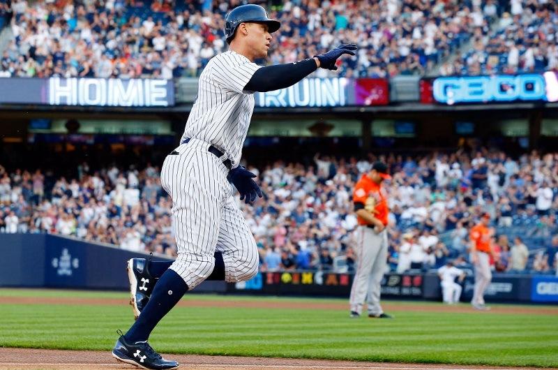 Aaron Judge rounds the bases after hitting a home run off Chris Tillman at Yankee Stadium.