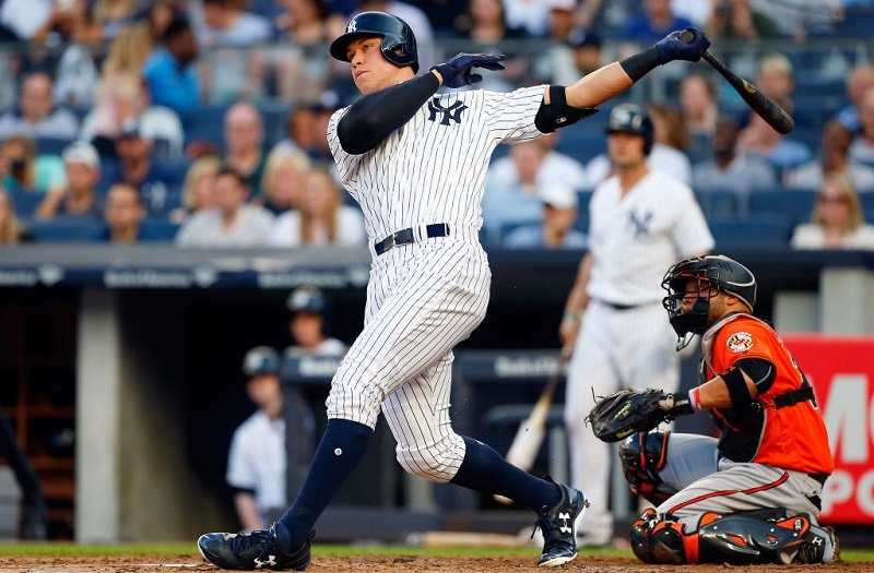 Judge follows through on a home run to left field at Yankee Stadium on June 10, 2016.