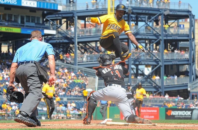 Andrew McCutchen of the Pittsburgh Pirates is tagged out at home plate by J.T. Realmuto of the Miami Marlins.