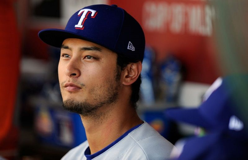 Yu Darvish watches from the dugout.