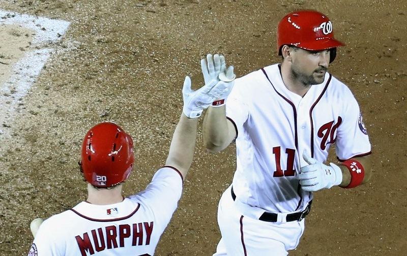 Ryan Zimmerman high-fives Daniel Murphy at Nationals Park.