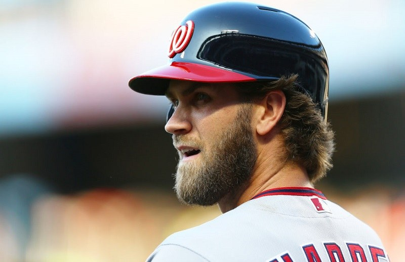 Before batting, Bryce Harper looks out at the New York Mets' Citi Field.
