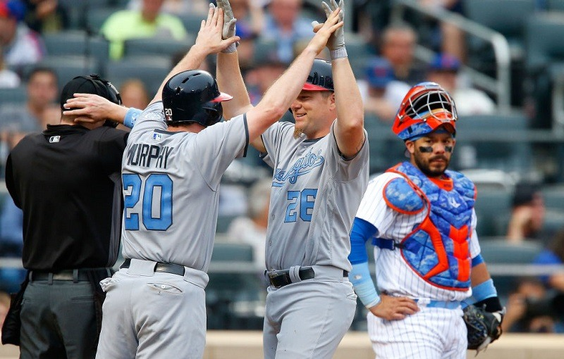 Adam Lind and Daniel Murphy celebrate against the New York Mets.