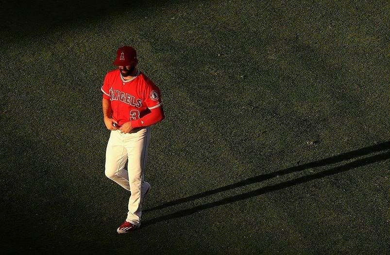 Danny Espinosa of the Los Angeles Angels of Anaheim walks in the outfield.