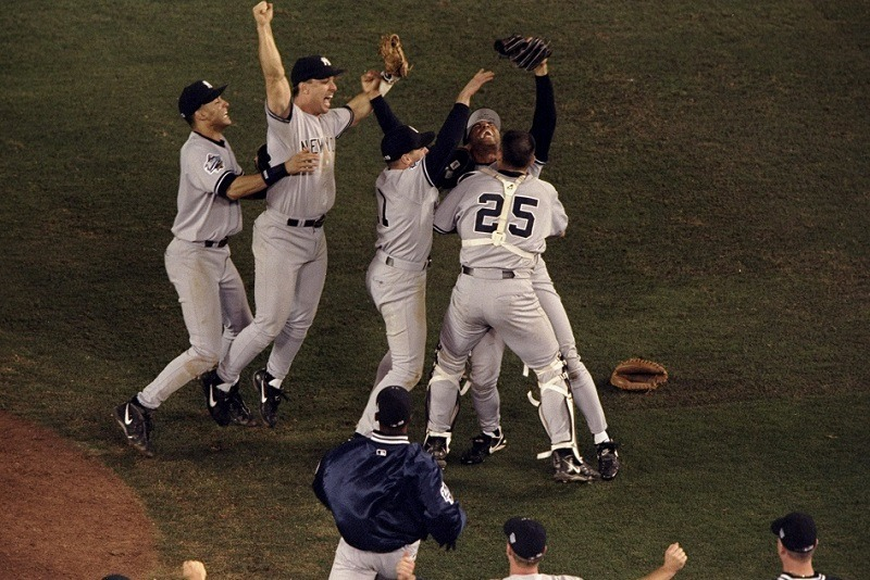 Derek Jeter, Tino Martinez, and Chuck Knoblauch join Mariano Rivera and catcher Joe Girardi in celebration after the last out of the 1998 World Series.