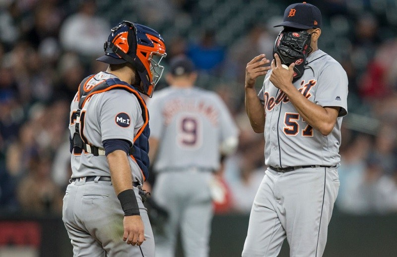 Catcher Alex Avila and relief pitcher Francisco Rodriguez of the Detroit Tigers meet at the pitcher's mound.