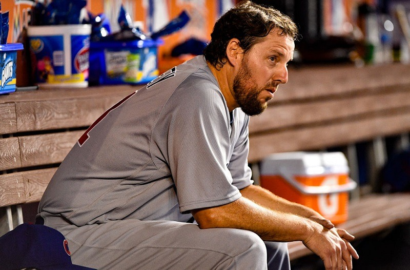 John Lackey of the Chicago Cubs rests in the dugout.