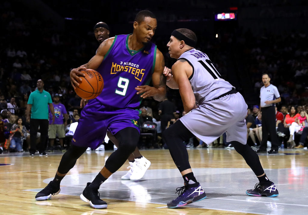 Rashard Lewis goes to work against Mike Bibby.