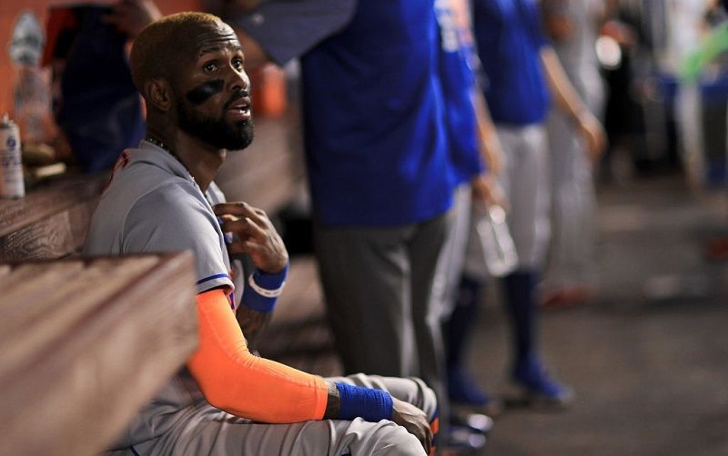 New York's Jose Reyes sits on the bench during a game at Marlins Park.