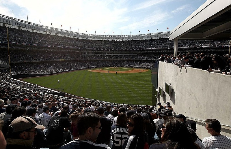 Fans sit in the obstructed view seats in the bleachers at new Yankee Stadium on April 16, 2009.