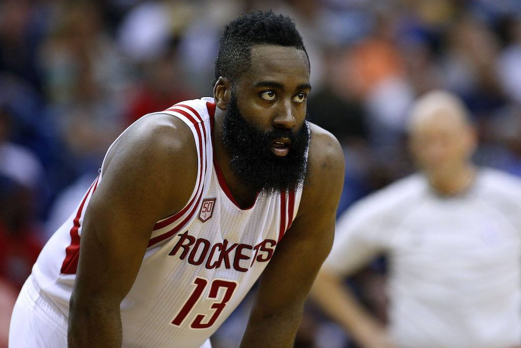 James Harden looks on during the game.