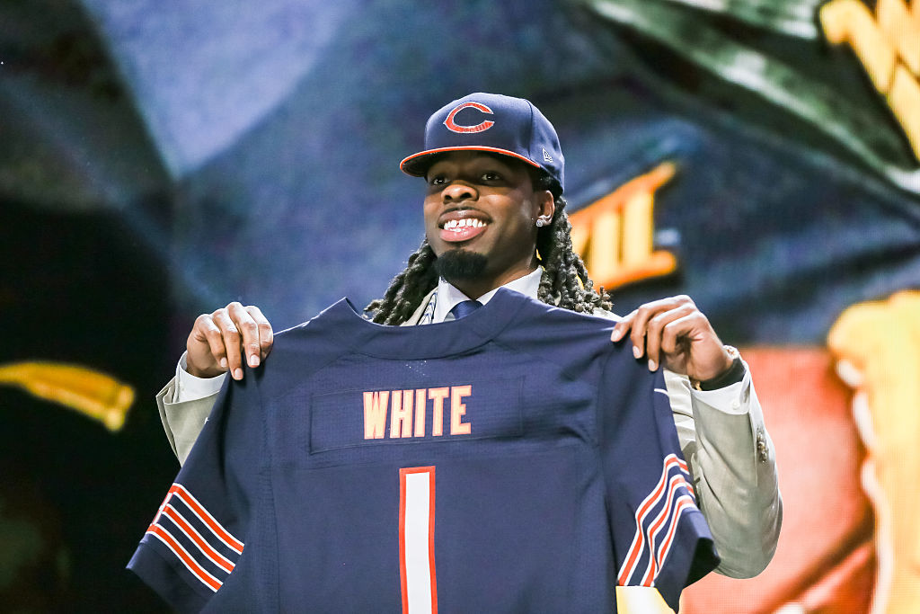 Kevin White of the West Virginia Mountaineers holds up his new jersey.