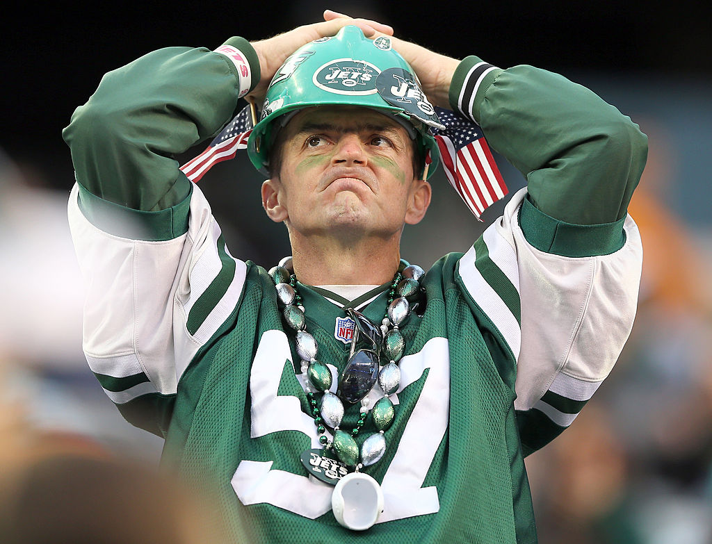 A New York Jets fans watches the final minutes of a game against the Miami Dolphins.