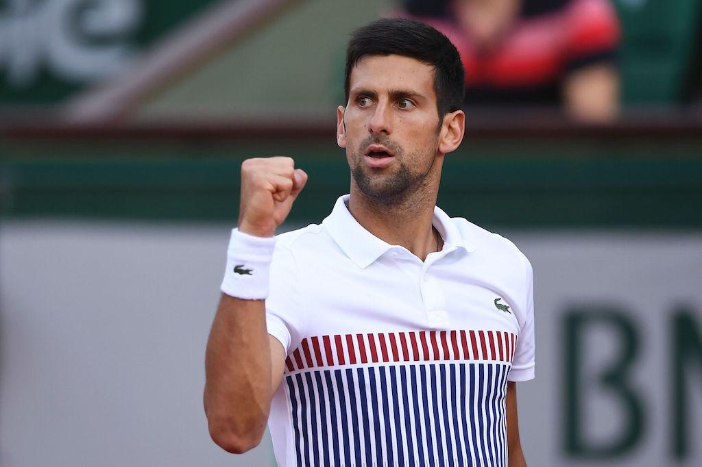 Novak Djokovic wins a point.
