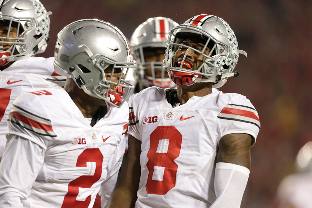 Gareon Conley of the Ohio State Buckeyes laughs with his teammate.