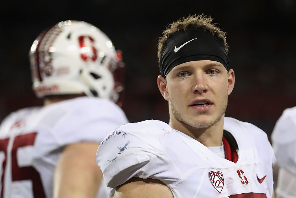 Running back Christian McCaffrey of the Stanford Cardinal talks on the sideline.