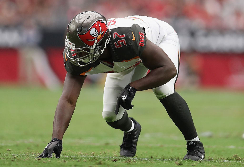 Defensive end Noah Spence of the Tampa Bay Buccaneers prepares to take off.