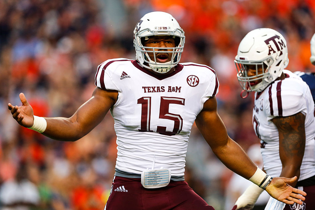 Defensive lineman Myles Garrett of the Texas disagrees with a call.