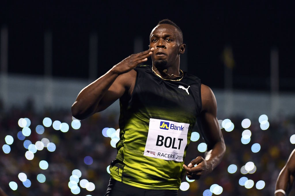 Usain Bolt crosses the finish line.
