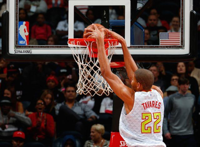 Walter Tavares dunks the ball.