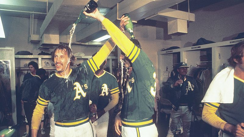Ken Holtzman and Rollie Fingers trade champagne showers on their way to the World Series in 1973.