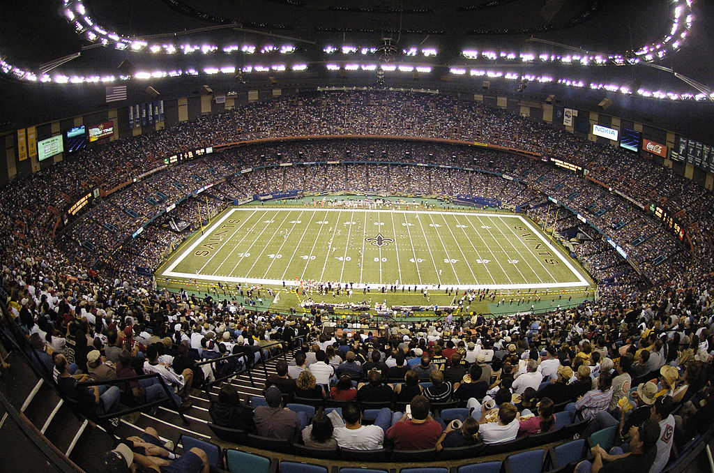 Fans sit in their seats at the Mercedes-Benz Superdome, waiting for a Saints game to begin.
