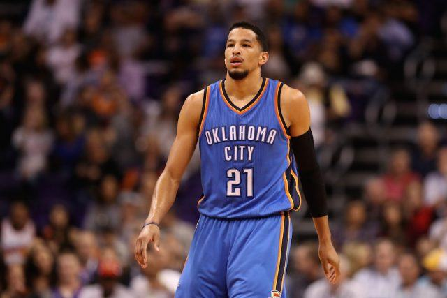 Andre Roberson walks up the floor.