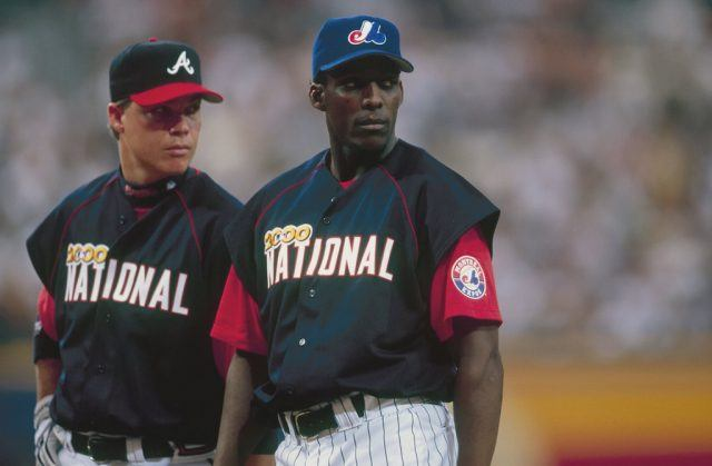 Vladimir Guerrero (R) and Chipper Jones look on during the 2000 MLB All-Star Game.