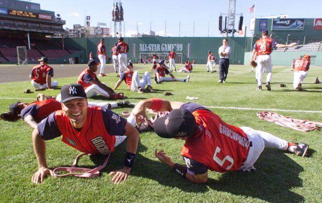 Derek Jeter and Nomar Garciaparra stretch during batting practice.