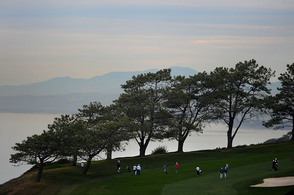 Golfers walk across Torrey Pines Golf Course in La Jolla, California before the Farmers Insurance Open.