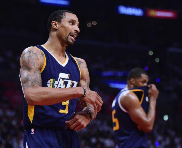 George Hill looks for a foul.
