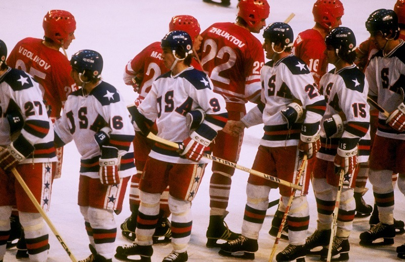 The teams from the United States and the Soviet Union shake hands after the semifinal hockey game during the Winter Olympics.