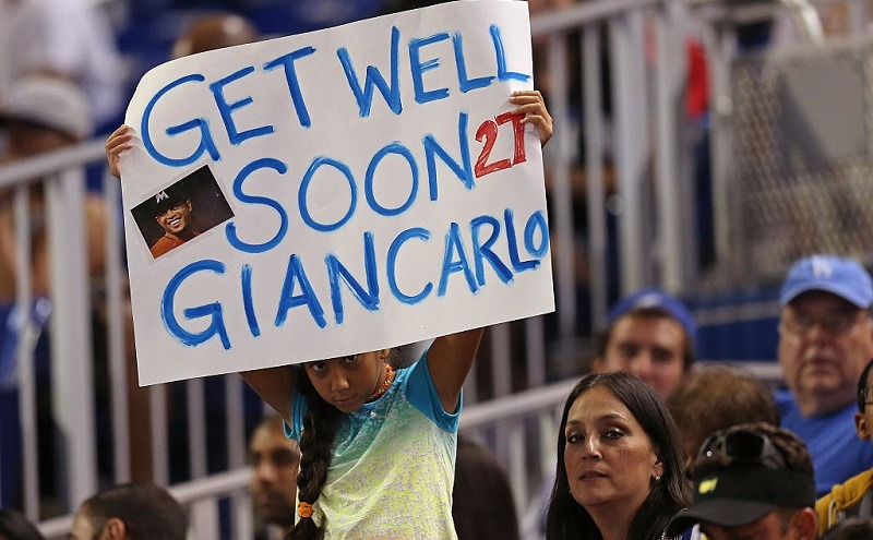 A fan holds a sign in between innings of Miami Marlins game.