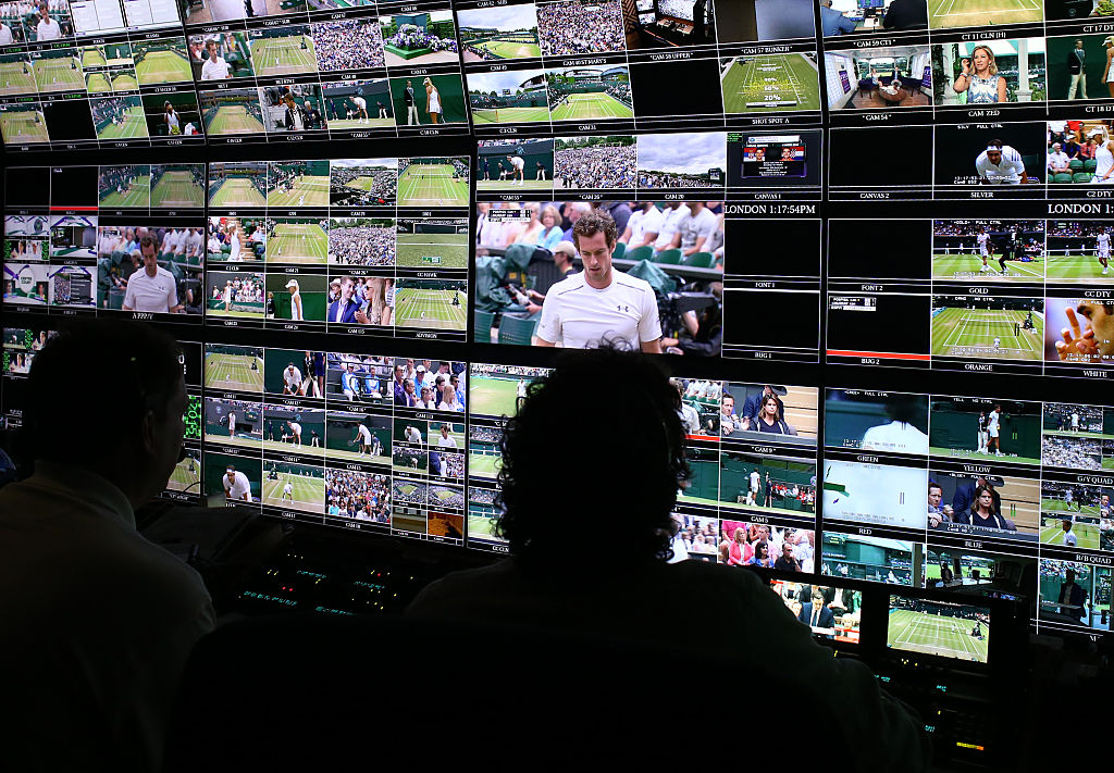 Production staff view screens in an ESPN operation room during Wimbledon.