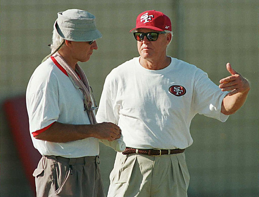 Bill Walsh talks with a San Francisco 49ers coach.