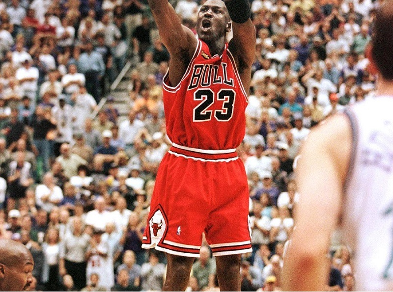 With 5.2 seconds left in the game, Michael Jordan of the Chicago Bulls aims and shoots the game-winning jump shot as Bryon Russell of the Utah Jazz drives at Jordan's feet.