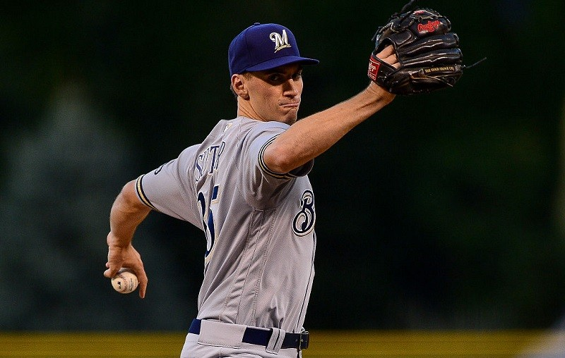 The Brewers' Brent Suter concentrates on pitching.
