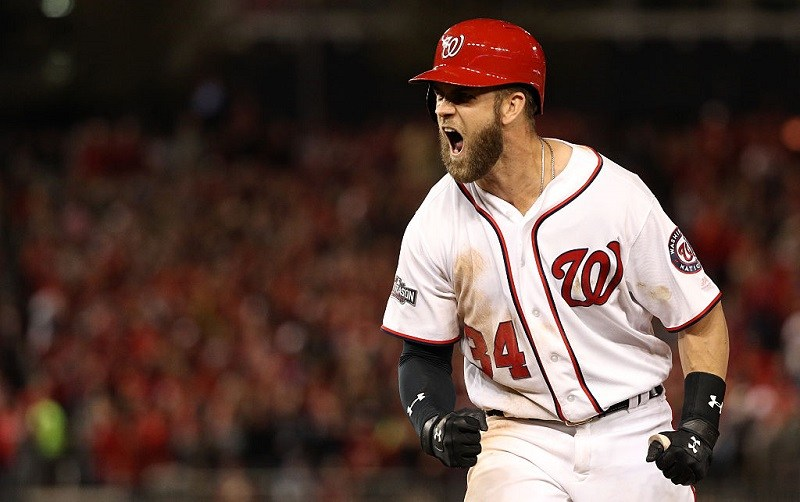 Bryce Harper #34 of the Washington Nationals reacts after hitting a single.